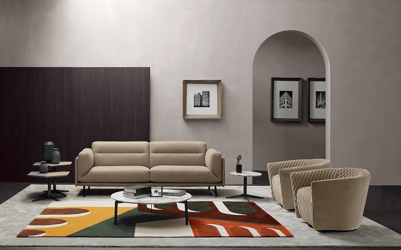 beige leather 2-seater sofa with silver legs, modern simple stylish sofa with matching armchairs with capitone look, marble circular coffee table, marmarino kentriko trapezaki,