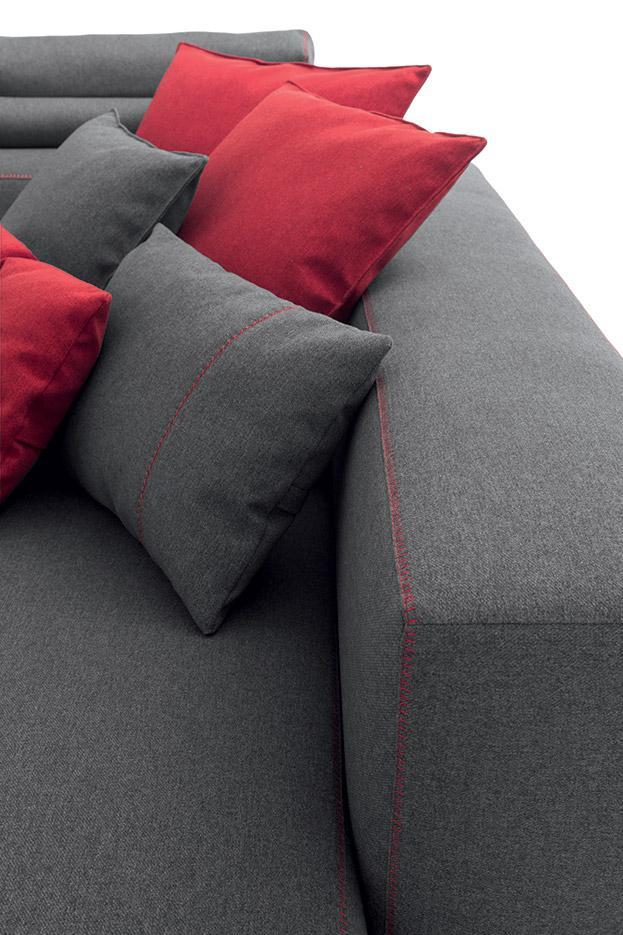 fabric grey sofa with red seams, close up fabric texture and seams colors, kontini opsi gkrizou kanape me kokkines rafes,
