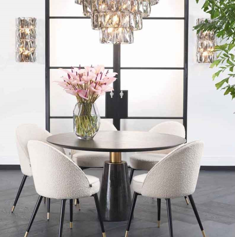 white fabric chair with black and gold legs, wooden with nice base dinning circular table,