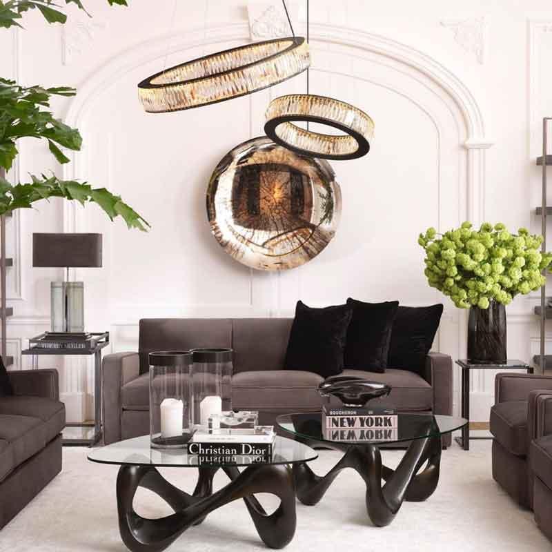 black wooden leg with clear glass top, grey velvet sofa with black cushions, mavro skouro kormos xilou trapezi kentriko,