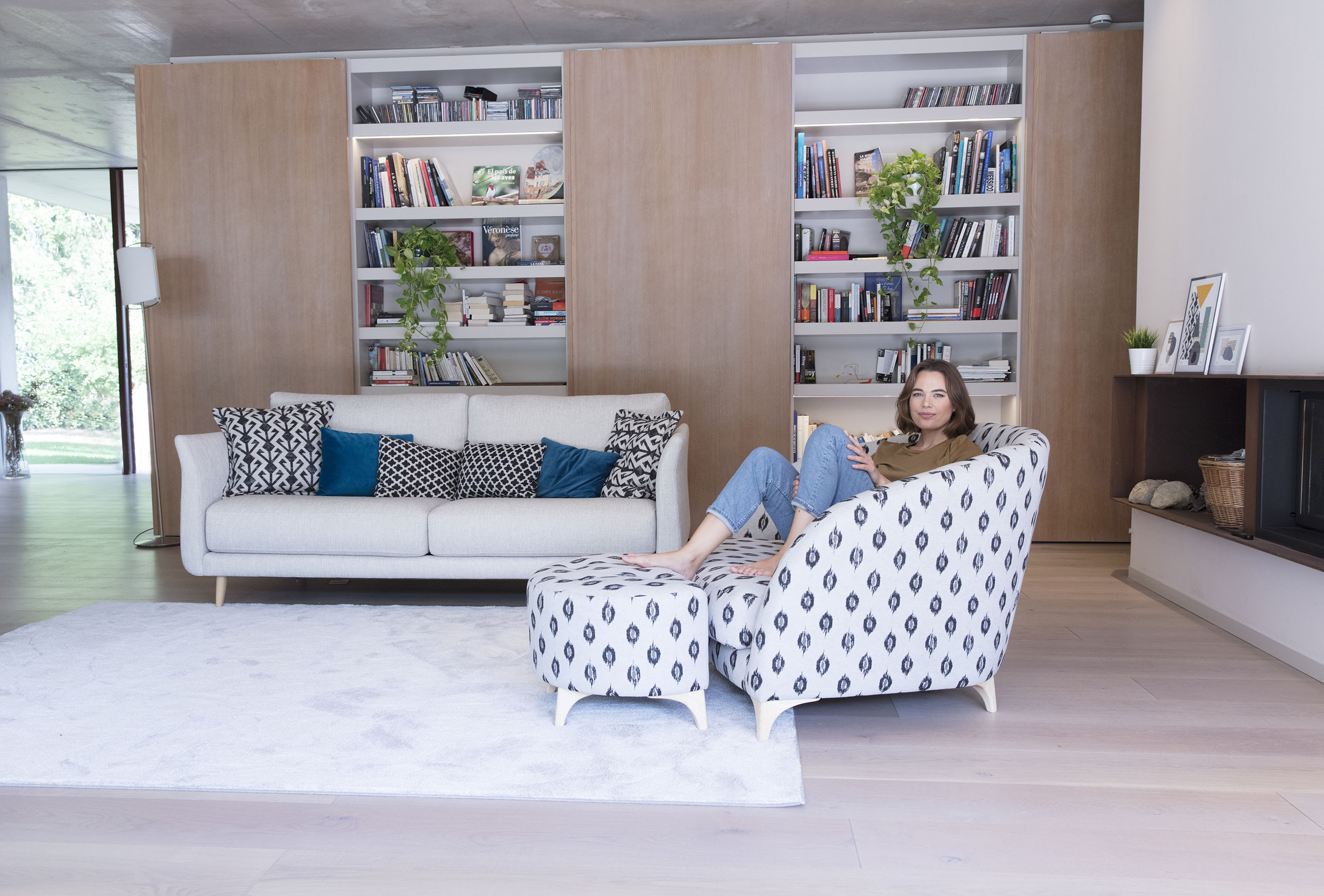 2 seater fama sofa with high wooden legs grey fabric matched with patterned sofa with its footstool ,