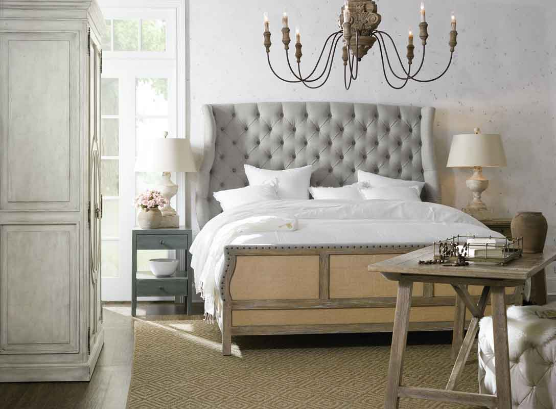 grey fabric bed with wooden details on its bottom and low legs, high capitone grey fabric headboard simple wooden vintage bed, kapitone krevati me psili kerfalaria kai xilines leptomeries,