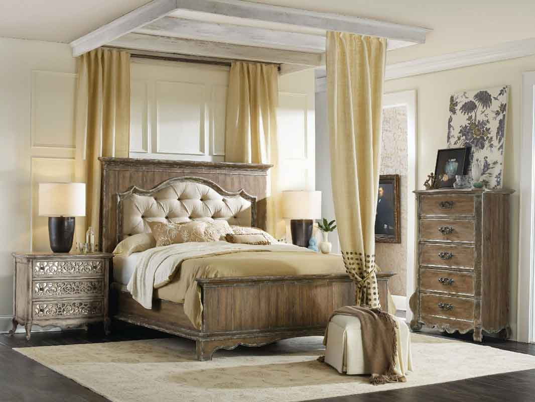 grey wooden capitone high headboard bed beige colors and low legs,