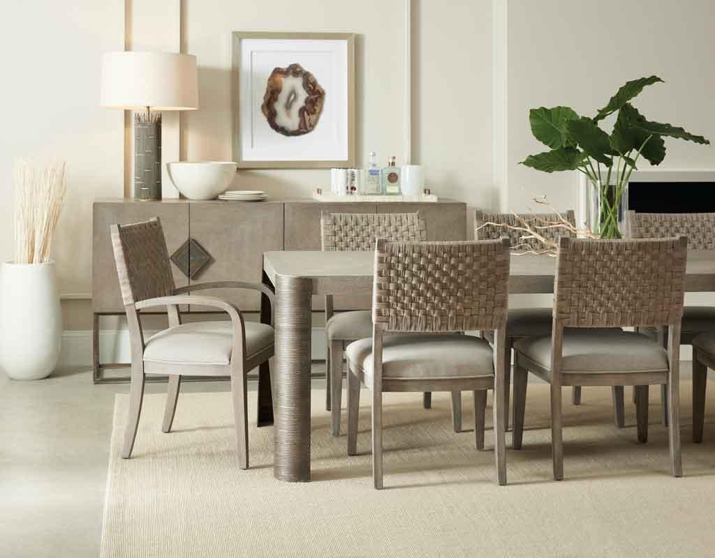 minimal design dinning table with circular leg and wicker style dinning chairs, xilino trapezi me stroggilo podi megalo orthogonio me psathenes karekles,