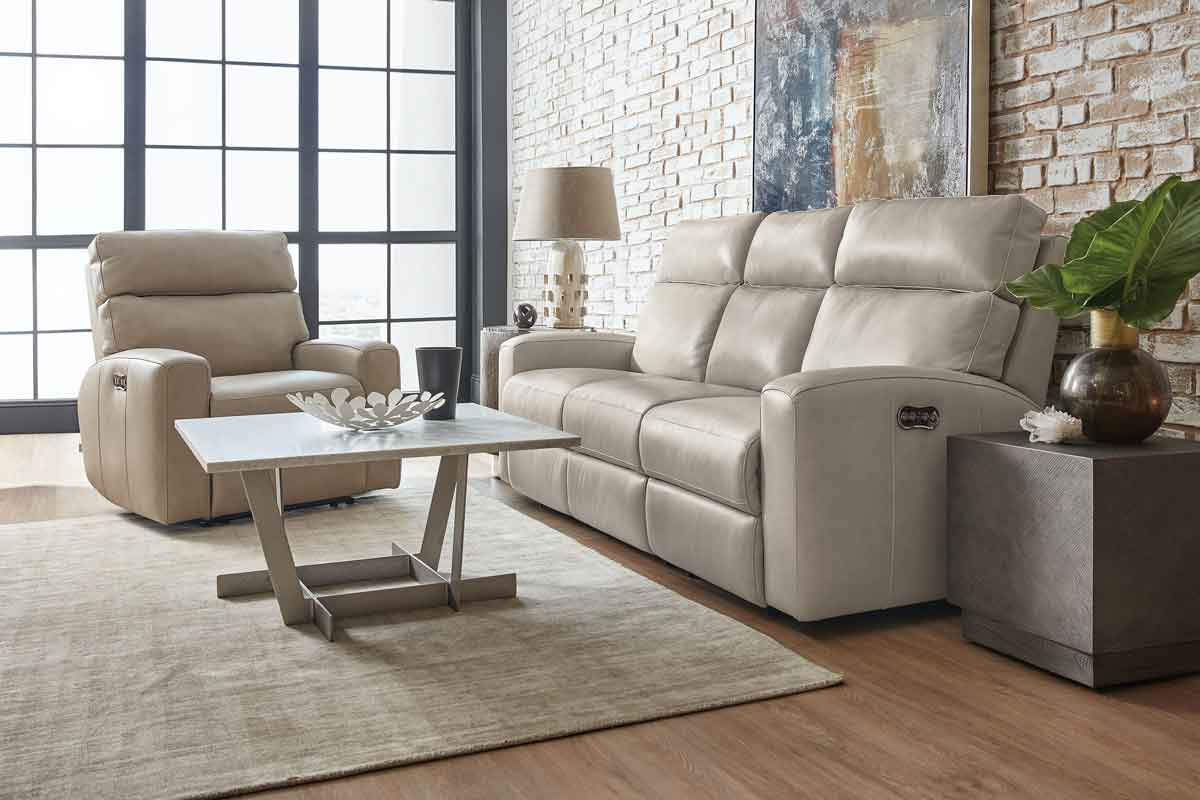 white leather comfy sofa with its matching armchair, wooden coffee table with sides tables, sofas that are extendables on the bottom part,