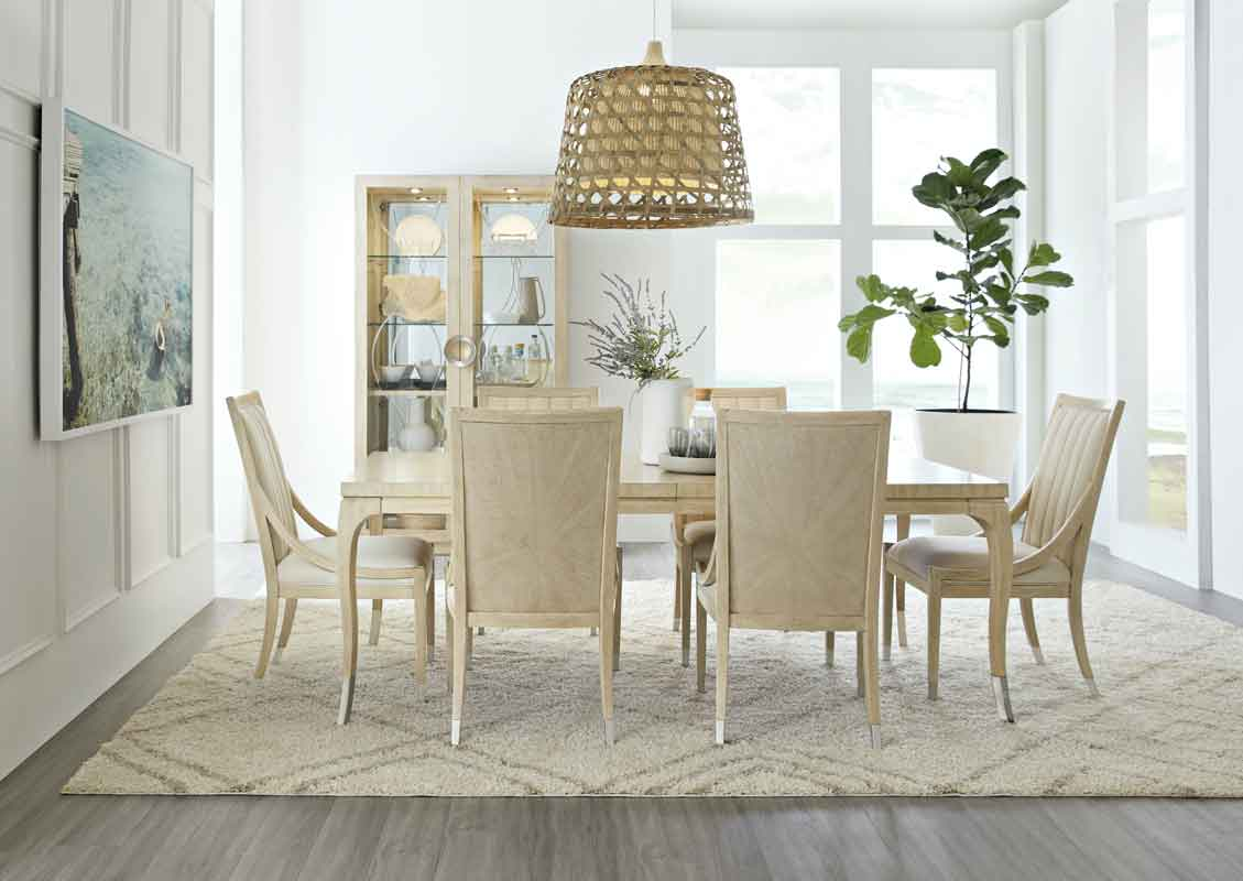 rectangular dinning table clean minimal desgn with silver detail on its leg, minimal style dinning chair beige wooden italian chairs,