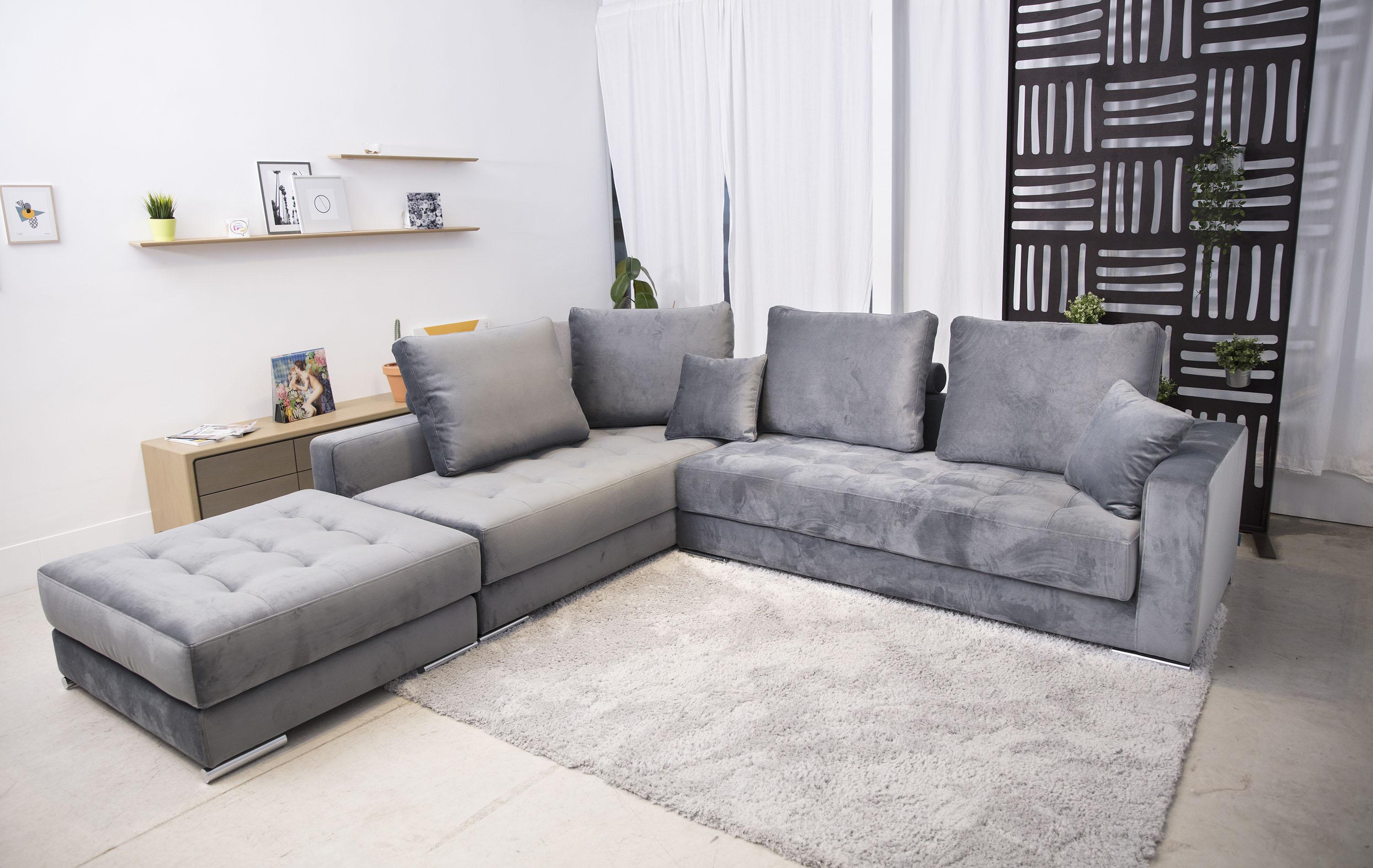 grey velvet corner sofa stylish with silver legs.