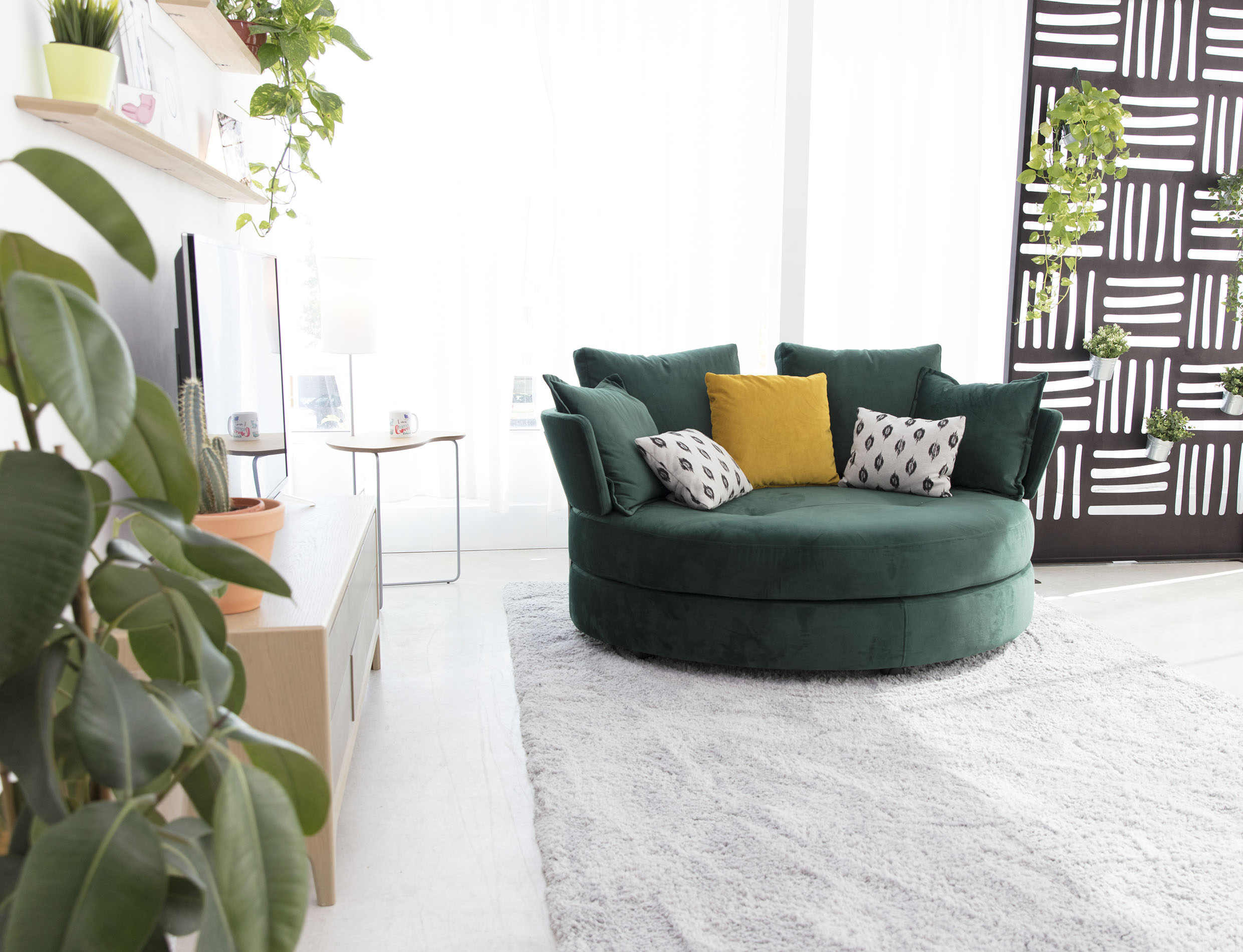 minimal green velvet turning armchair with no legs, comfy huge king size armchair for 2 people,