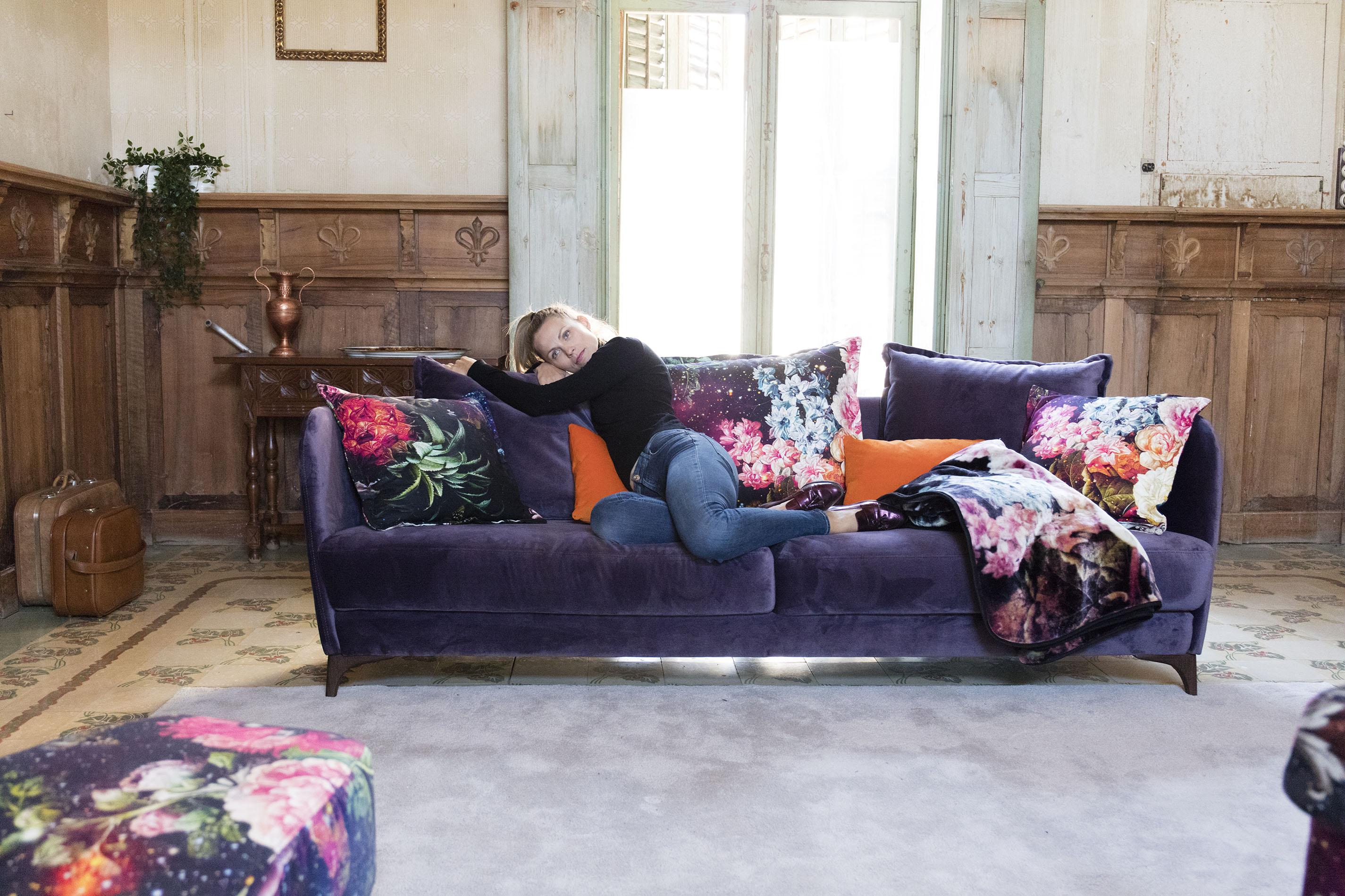 purple velvet 2 seater sofa with dark wooden legs, classic shape sofa with colourful cushions , adjustable fabric sofa,