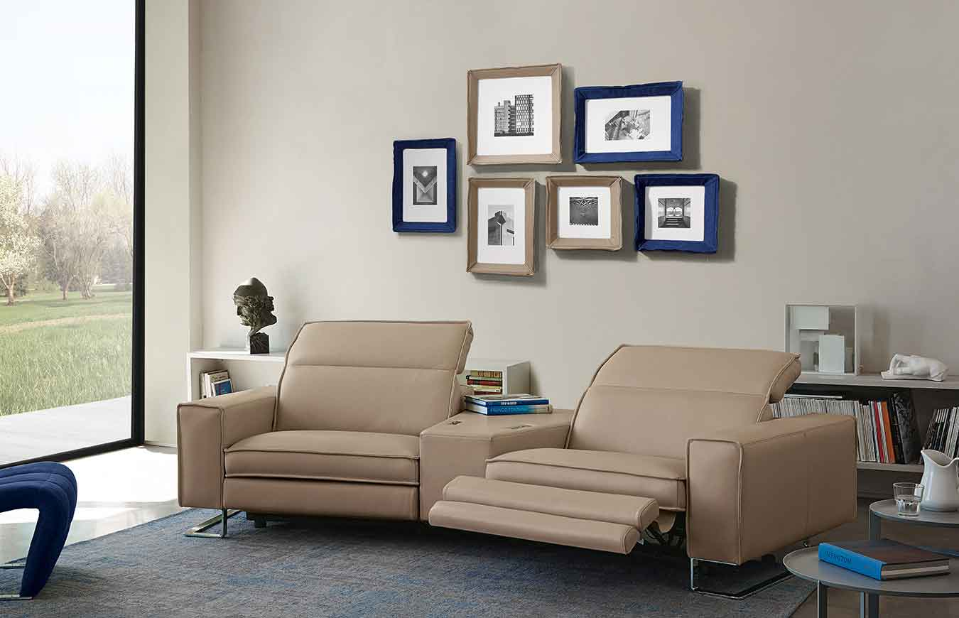 leather armchairs connected with a table in the middle with silver legs, real beige leather armchairs with mechanism that opens, modern luxury real leather sofas with leather table in the middle, polithrones dermatines me asimenia podia pou anigoun sta po