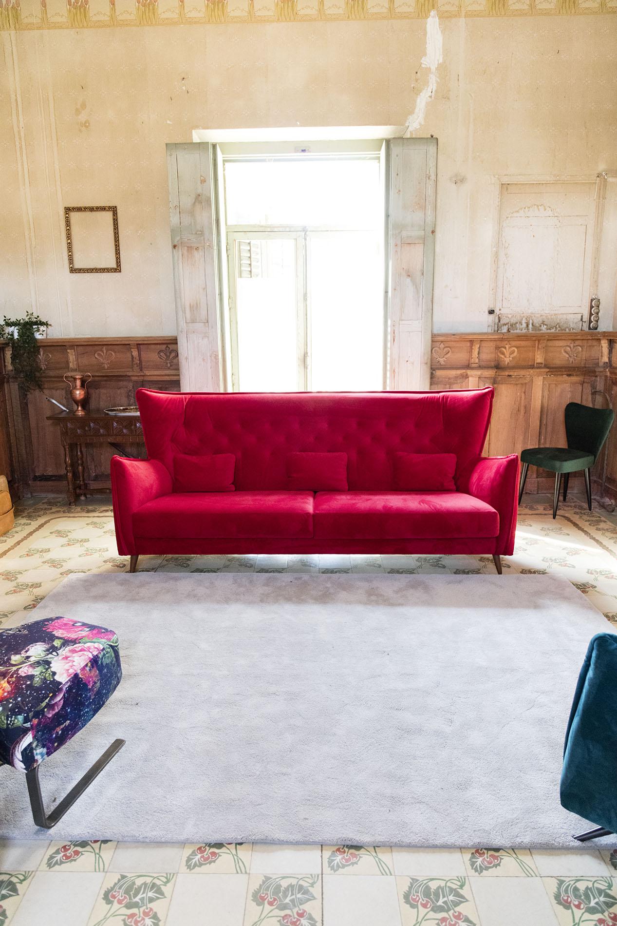 red stylish sofa with wooden legs, modern minimal style sofa with cushions, kokkinos kanapes me xilina podia,