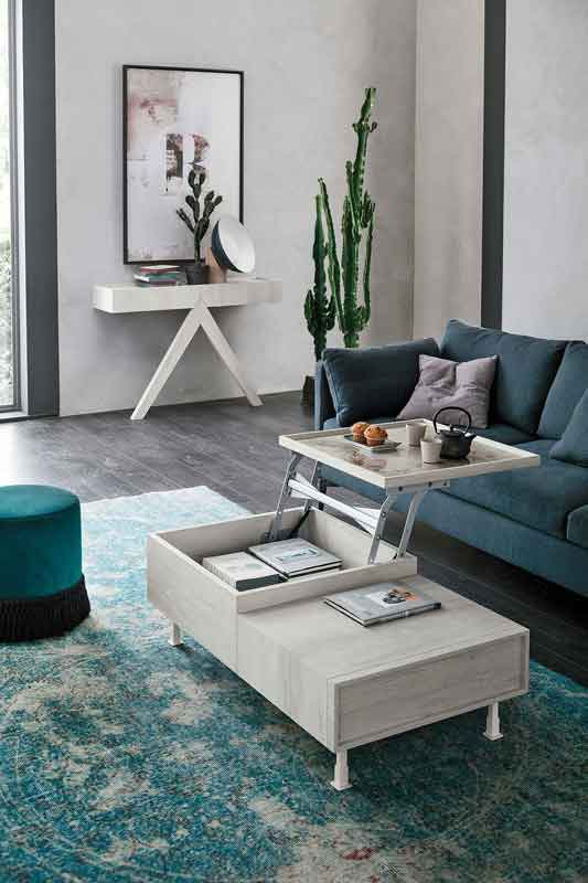 low wooden grey coffee table that opens up, blue sofa fabric with silver legs,