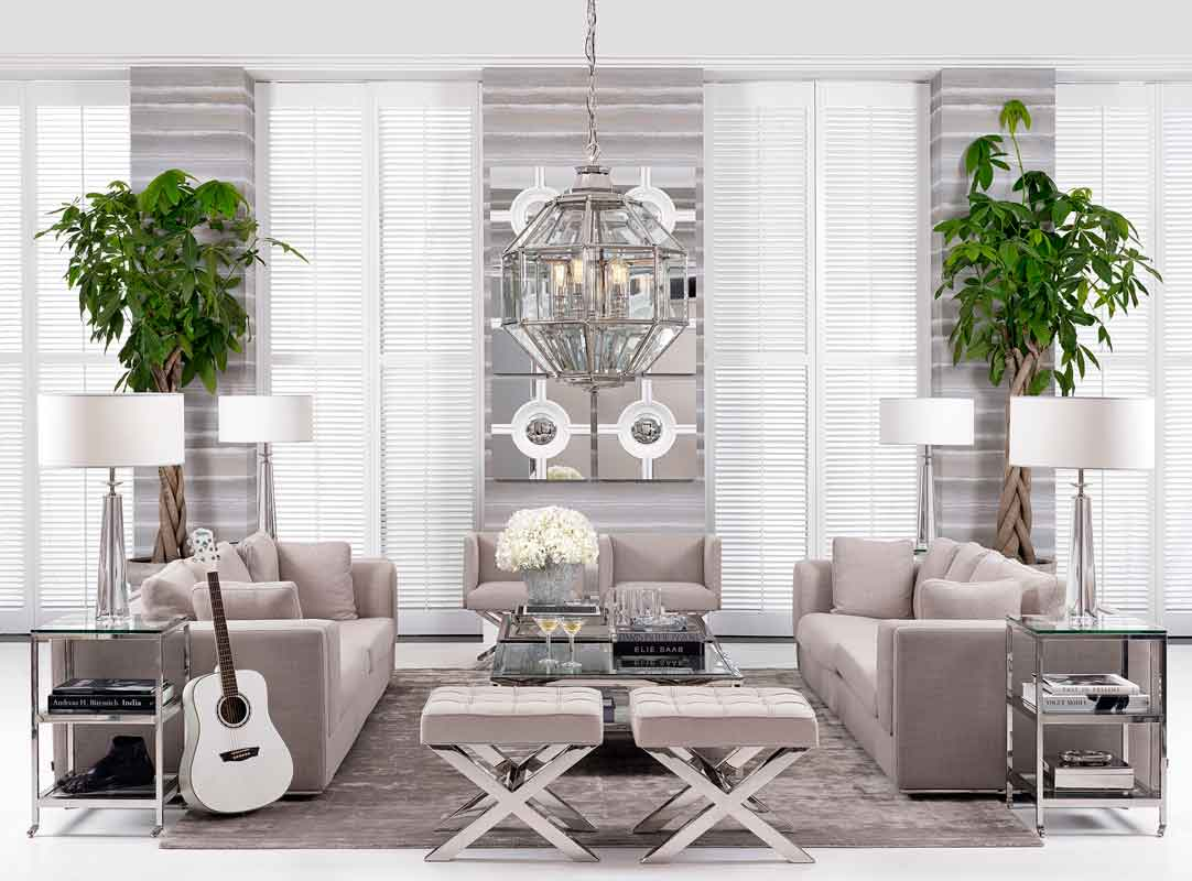 silver living set luxury with coffee table 3 seater sofas and armchairs, fabcric comfy sofas with cushions and silver coffee table with silver matching legs with the sofa,
