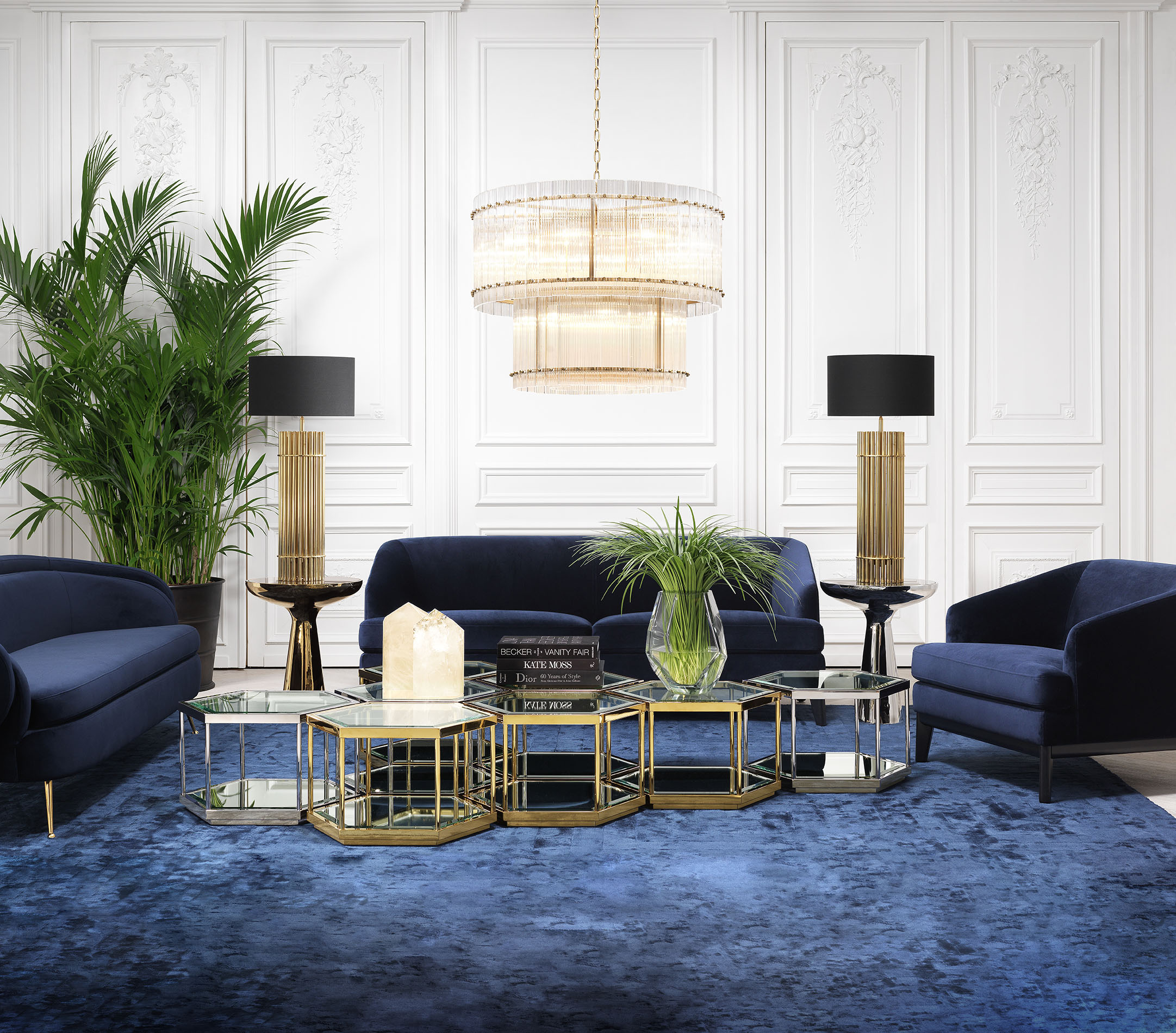 blue velvet living set armchairs and sofa with gold accessories, gold high lamps stand with black hats, blue velvet sofa with black legs, gold and silver modern coffee tables, trapezakia kentrika asimenia kai xrisa, mple veloudini kanapes me karekla me ma