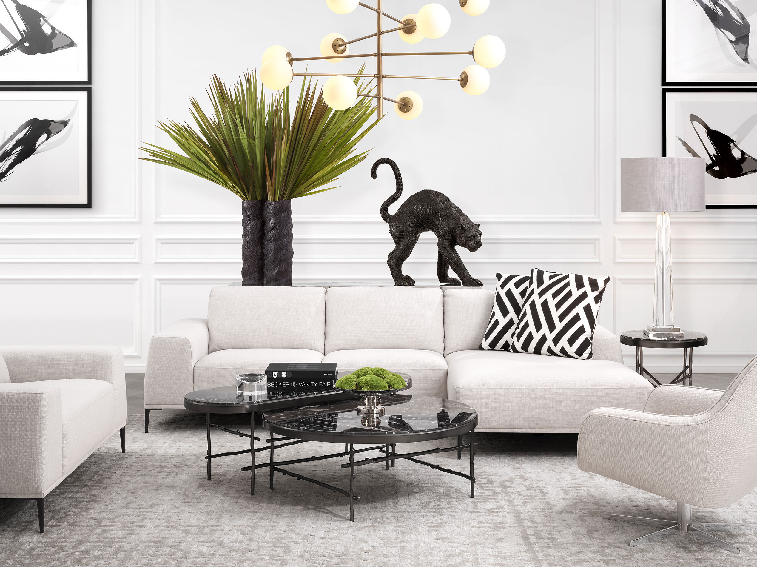 white comfy sofa with chaise long with black legs, marble central coffee table with black legs, swing chair with silver legs, karekla peristrefomeni me asimenia podia, kanapes me mavra podia,