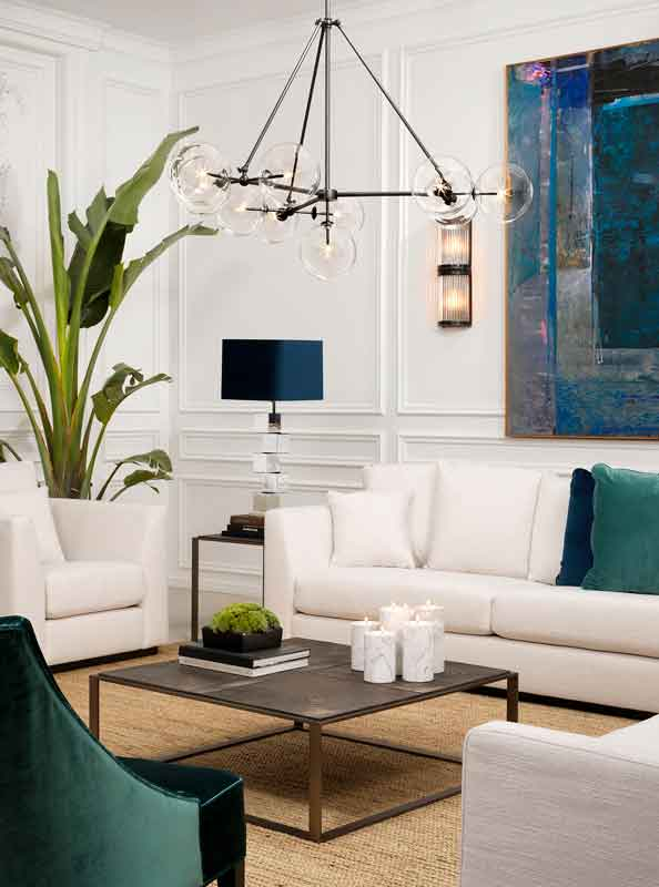 modern black chandelier, ceramic top coffee table, 3 seater comfy white sofa with black legs, aspros kanapes me mavra podia me keramiko trapezaki tetragono,